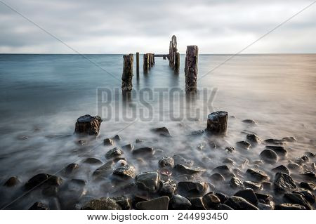 A Long Exposure Image Of An Abandoned Jetty On Strangford Lough, Northern Ireland.