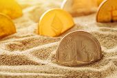 Silver Litecoin coin in sand, conceptual image for lost and found valuable cryptocurrency coins that are standing the test of time. poster