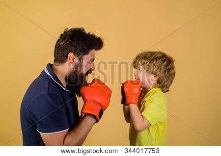 Little Kid Boxing. Dad And Son In Boxing Gloves. Child And Instructor Training In Boxing Ring. Happy