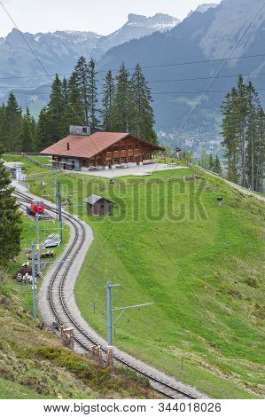 Idyllic Landscape. Railway Track And House In Swiss