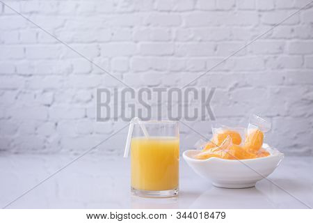 Glass Of Mangoes Juice And Mangoes Jelly On White Board.