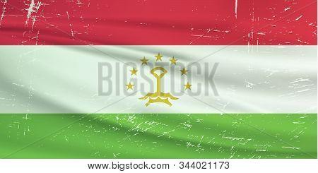 Grunge Tajikistan Flag. Tajikistan Flag With Waving Grunge Texture. Vector Background.