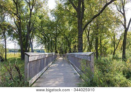 Boardwalk At Edge Of Long Meadow Lake Unit Of Minnesota Valley National Wildlife Refuge In Bloomingt