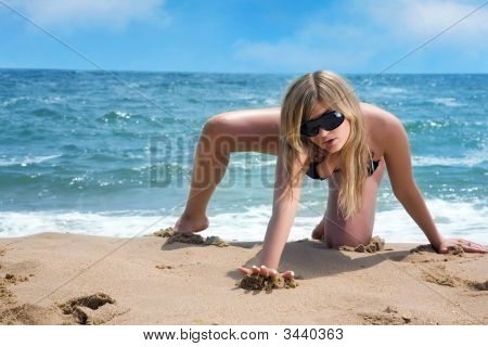 Attractive Girl Playing In The Sand