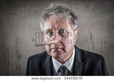 Dishonest puppet business man with a long wooden nose, liar concept