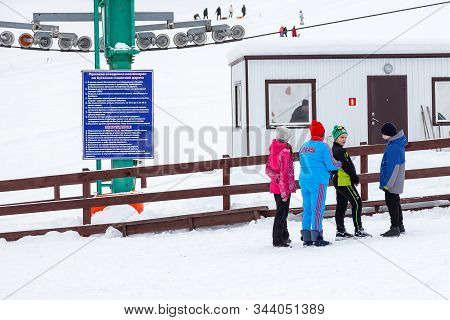 Altai, Russia - 01.01.2020: Four Children In Sportswear, One Of Them Is A Fat Girl On A Ski Resort I