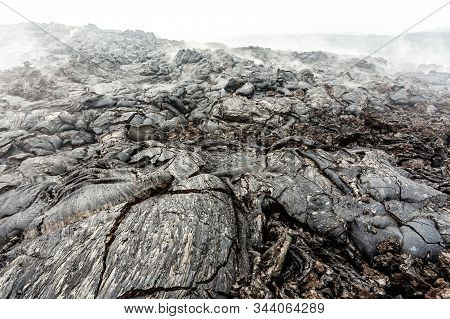 Solid Lava After Volcanic Eruption. Lava Fields Close Up, Natural Textured Background.