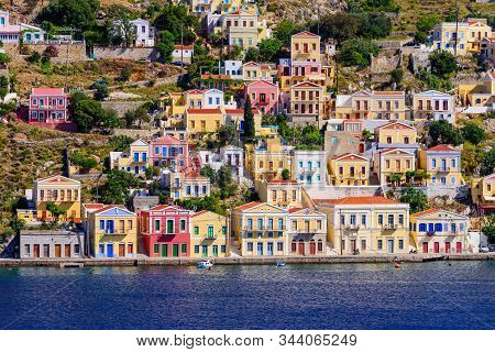 Sightseeing Of Greece. The Picturesque Coastline Of Symi Island With Beautiful Old Houses, Symi Isla