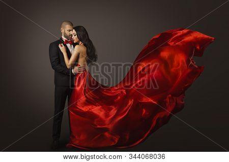 Couple Beauty Portrait, Beautiful Woman Dancing In Red Dress And Elegant Man, Cloth Fluttering On Wi