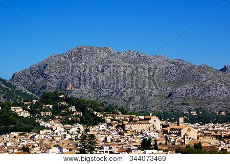 View Of Pollenca City With Mountains In Background, Mallorca, Spain 2018. Beautiful Blue Sky In Back