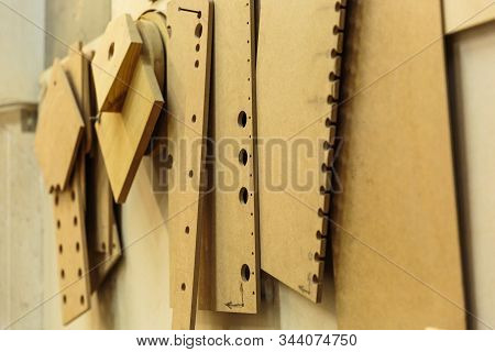 Wood processing. Joinery work. wooden furniture. Wood timber construction material for background and texture. details wood production. composition wood products. small depth of field poster
