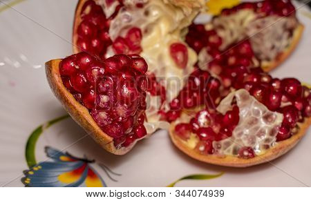 Ripe Juicy Pomegranate With No Seeds On The Plate