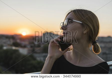 Young Business Woman Using Smart Mobile Phone, Outside Office Building And Speaking With A Business