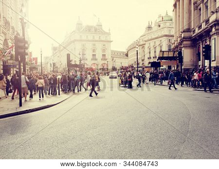 Piccadilly Circus, London, UK: Aug 2014: Crowds of people in the famous Piccadilly Circus area of London