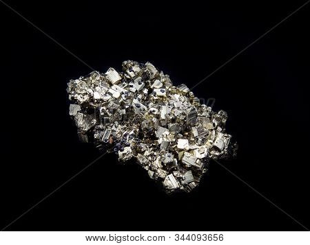 Iron Pyrite Crystals Clusters On Black Background