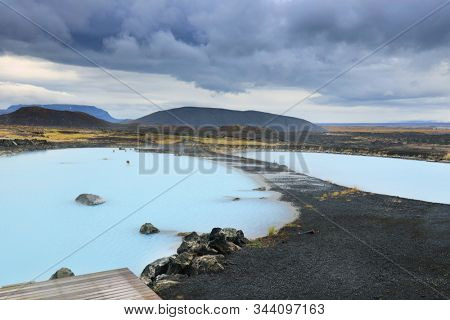 MYVATN, ICELAND, 24 OCTOBER, 2019: Tourists enjoying the hot geothermal water at Myvatn pools, Iceland, Europe