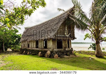 Old Traditional Thatched Yapese Men's Meeting House Faluw Or Fale, On An Elevated Limestone Platform