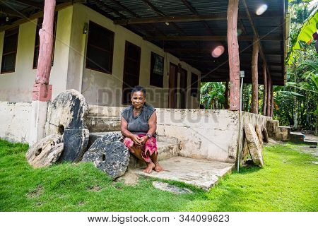Yap Island, Micronesia - Aug 04 2015: Local Micronesian Native Women Sitting On On The Porch Of An A