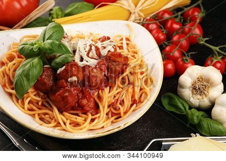 Spaghetti Pasta With Meatballs And Tomato Sauce With Basil And Parmesan