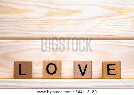 Love Made Of Wood Background. Love Concept. Love Sign, Emotions Concept. Word Love Made Of Wood Bloc