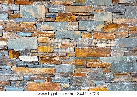 Stone Brick Wall Pattern Texture Background. Asymmetrical Wall Of Modern Architecture. Background Of