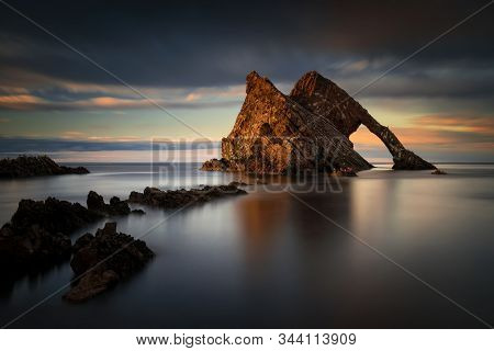 Bow Fiddle Rock Formations In Dusk, Portknockie, Scotland