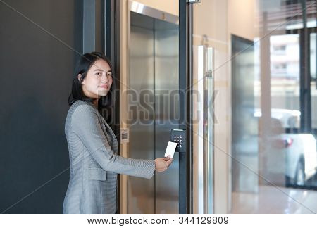 Door Access Control - Young Officer Woman Holding A Key Card To Lock And Unlock Door For Access Entr