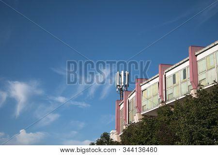 Telecommunication Cellular Base Station On A Building, 4g And 5g Cellular. Base Station Or Base Tran
