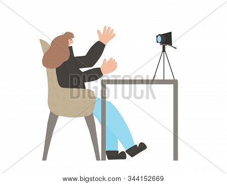 Young Blogger Sitting And Recording A Video. Cute Woman Waving Her Hands And Making Exaggerated Gest