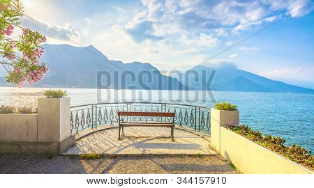 Bench On Lakefront In Como Lake Landscape At Sunset. Bellagio Italy Europe
