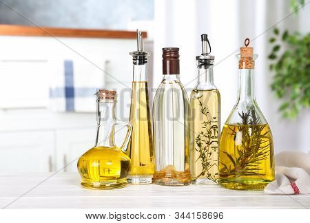 Different Sorts Of Cooking Oil In Bottles On Table Indoors