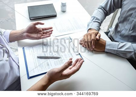 Doctor Having Conversation With Patient While Discussing Explaining Symptoms Or Counsel Diagnosis He