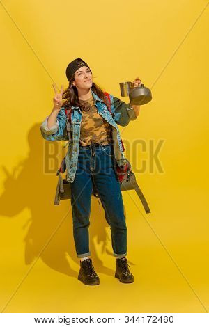Tea Time On Nature. Portrait Of A Cheerful Young Caucasian Tourist Girl With Bag And Cups Isolated O