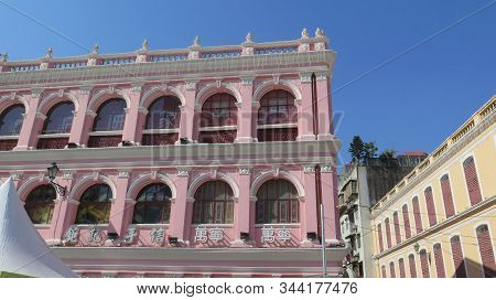 Macao, East Asia - November 21, 2019: Pink Marble Frontage Old Old Macao Building On Sunny Day
