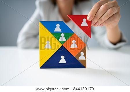 Businesswoman Building Tangram Square Block