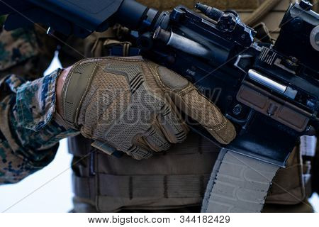 american  marine corps special operations soldier preparing tactical and commpunication gear for action battle closeup studio portrait isolated on white background