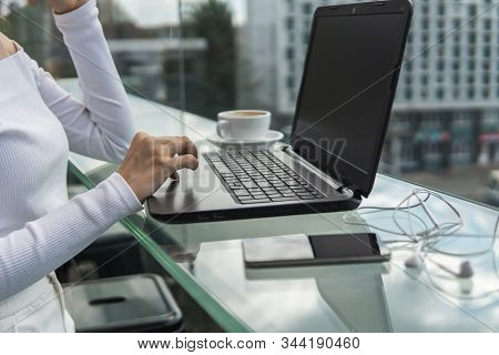 A Woman Is Working By Using A Laptop Computer On Table. Hands Typing On A Keyboard. Female Businessm