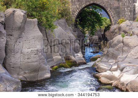 Old Stone Bridge Over River Alcantara Near Castiglione Di Sicilia Village, Sicily In Italy