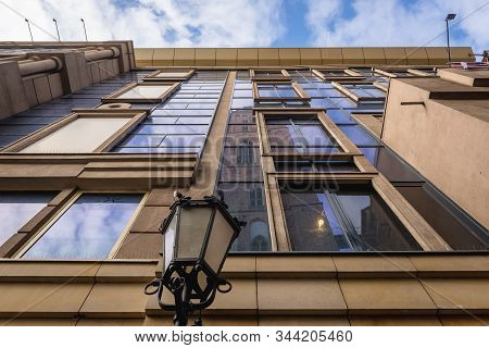 Tower Of St Elisabeth Basilica Reflected In Facade Of Townhouse In The Old Historic Part Of Wroclaw,