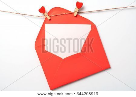 Letter Background, Note Design. Valentines Day Concept. Symbol Of Love, Copy Space. Clothes Pegs Wit