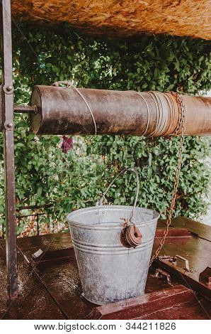 Old Water Well In The Garden. Draw Well In European Village. Country Side Lifestyle