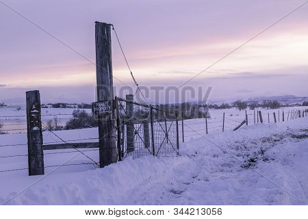 Winter Landscape Scene With Barbed Wire Fencing And A No Trespassing Sign