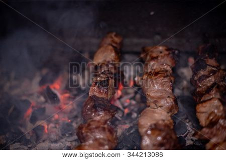 Close-up Of Grilling Tasty Dish On Barbecue. Process Of Cooking Yummy Shashlik In Nature. Delicious