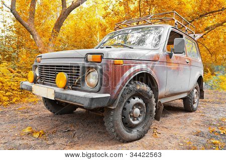 Offroad Vehicle In Autumn Forest