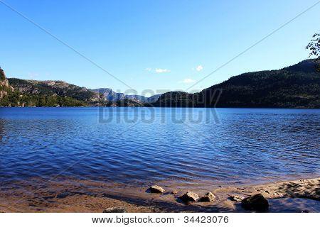 lake, shore and mountain