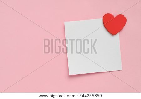 Blank Paper Note And Red Heart On Pink Paper Background. Mock-up, Copy Space.