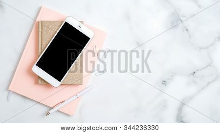 Home Office Desk Workspace With Smartphone Screen Mockup, Pink Notepad, Pen On Marble Background. Fl