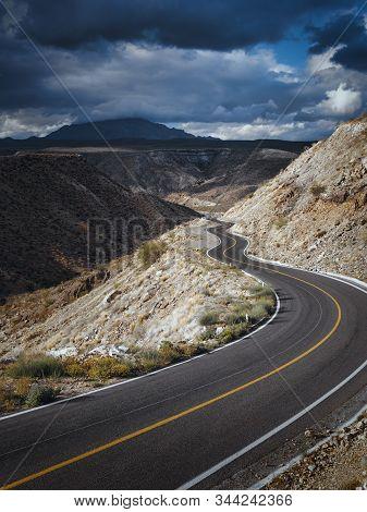 Dramatic Cloudscape Over Empty Road Through Scenic Canyon, Santa Rosalia, Baja California, Mexico