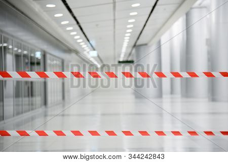 Red And White Lines Of Barrier Tape. At Subway Station Of Airport Background.red White Warning Tape