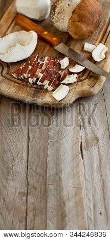 Wild Porcino Mushrooms On A Wooden Board Close Up